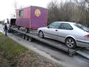 the dragonfly wagon on its trailer at its arrival